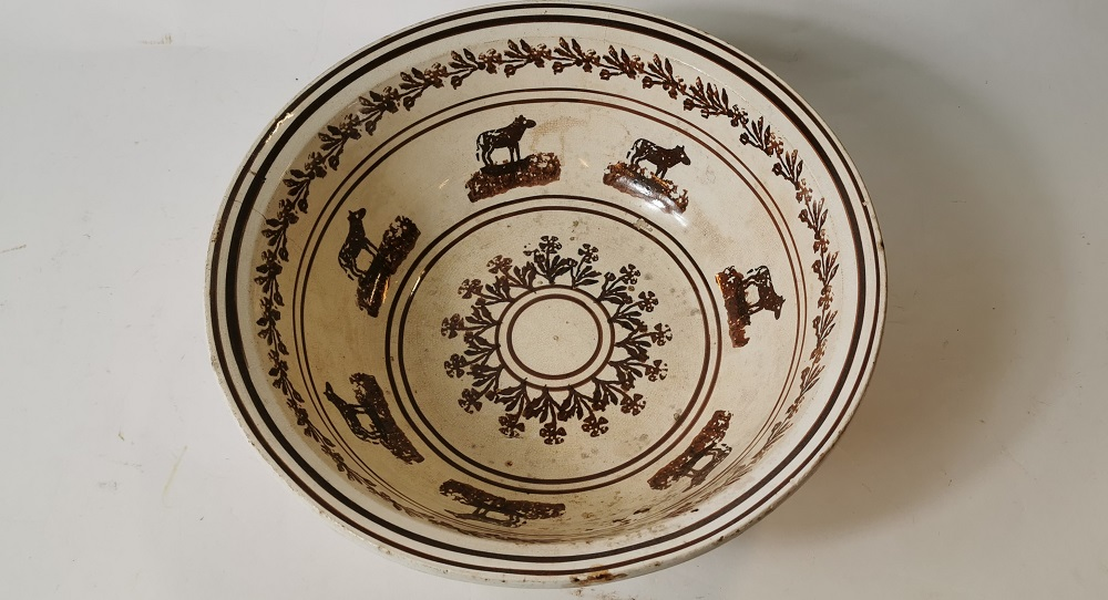 19th. C. brown and white spongeware cow potato bowl
