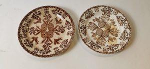 Brown and white spongeware plates