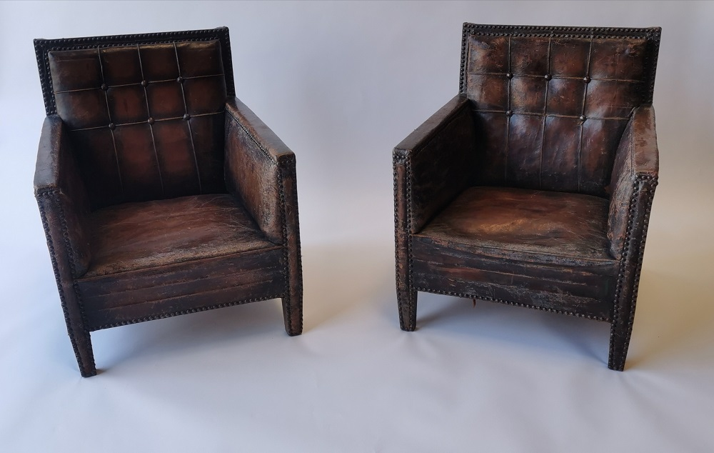 Pair of leather upholstered club chairs