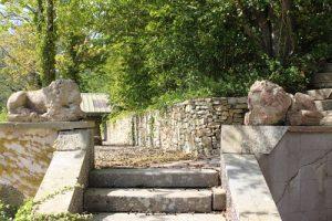 Pair of cast stone lions