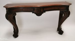 19th C. mahogany console table raised on cabriole legs